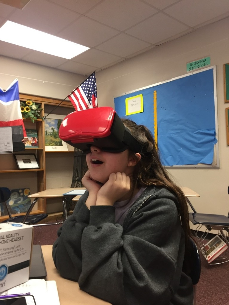 Sofia, a French I student, uses the class virtual reality goggles to explore the sights of Paris.