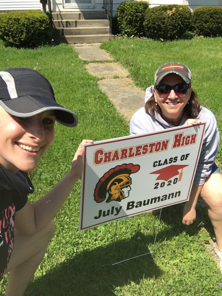 Two CHS faculty installing a yard sign