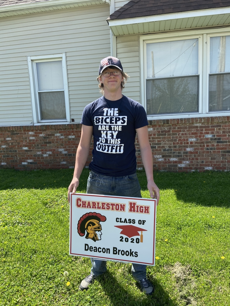 Student with yard sign