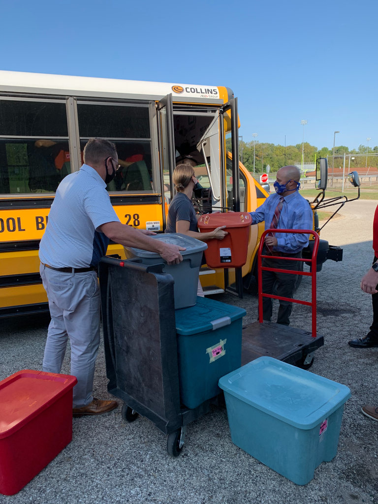 Assistant Superintendent, Mr. Burgett and Jefferson Assistant Principal, Mr. Marlo help load busses.