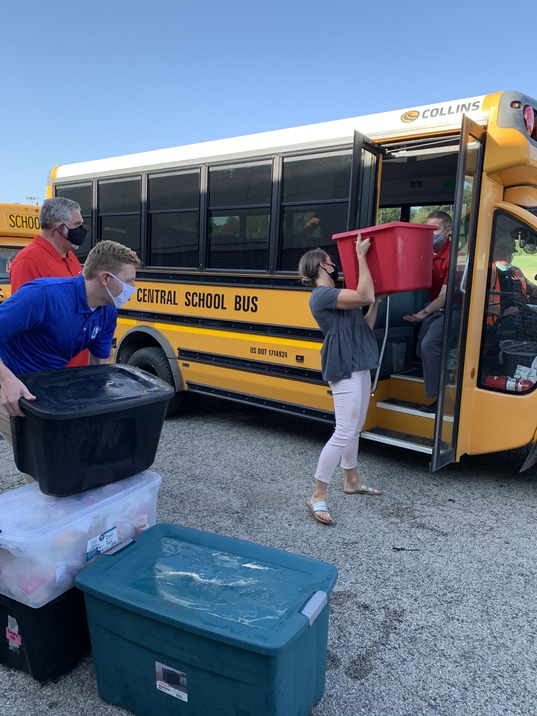 CMS Principal, Mr. Lynn, CHS Dean, Mr. Zerrusen, Carl Sandburg Assistant Principal, Ms. Schmitz and CHS Assistant Principal, Mr. Wood help load busses.
